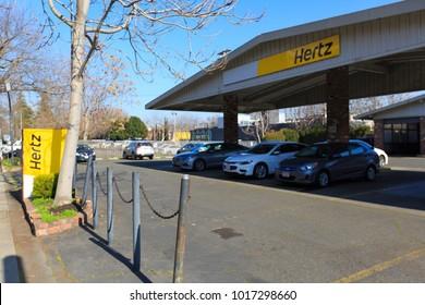 SACRAMENTO, CA, USA - FEB 2, 2018:  Hertz Company logo on Store front facade