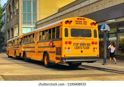 SACRAMENTO, CA, USA - MAY 29, 2018: Yellow American School bus parked for drop of downtown.