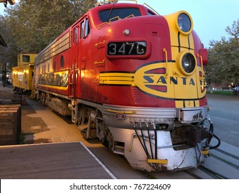 SACRAMENTO, CA, USA - NOV 28, 2017: Red and Yellow Train Locomotive in the Old Town of Sacramento