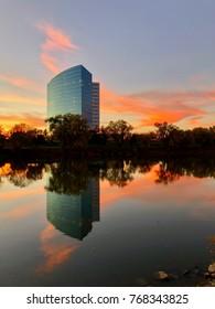 SACRAMENTO, CA, USA - NOV 28, 2017:  Buildings across the river in West Sacramento business area during Sunset .