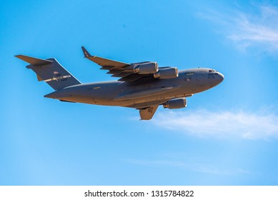 Sacramento, CA USA - October 10 2018 - A U.S. Air Force Boeing C-17 Globemaster III  passes over the city in its approach to Mather Airport