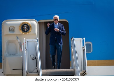 SACRAMENTO, CA, US.A. - SEPT. 13, 2021: President Joe Biden exits Air Force 1 and removes his mask before descending to get updated on the State's wildfires from the Office of Emergency Services.