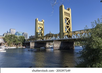 SACRAMENTO, CALIFORNIA - July 4, 2014:  Holiday boat users gather near the historic Tower Bridge in Sacramento, California.