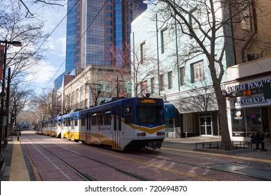 SACRAMENTO, CALIFORNIA - MARCH 5, 2017: Light rail train passing through downtown Sacramento, California.