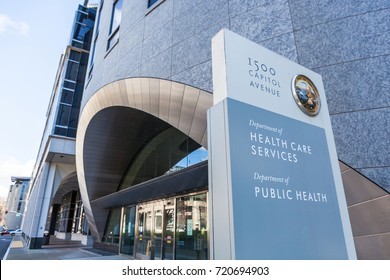 SACRAMENTO, CALIFORNIA - MARCH 5, 2017: Sign for the California Department of Health Care Services and Public Health Building.