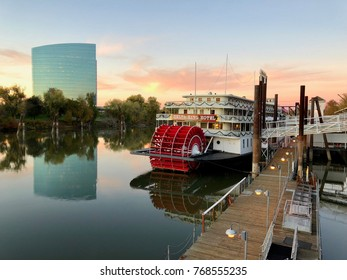 SACRAMENTO, CALIFORNIA - NOV 29, 2017:   Riverboat Delta King takes vistiors on a journey along the Sacramento River in California during sunset.