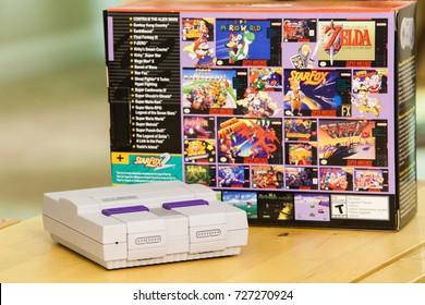 "SACRAMENTO, CALIFORNIA - OCTOBER 3, 2017: Console and box of Nintendo's hot new ""mini"" Super Nintendo, the Super Nintendo Classic Edition."