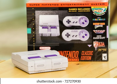 "SACRAMENTO, CALIFORNIA - OCTOBER 3, 2017: Console and box of Nintendo's hot new ""mini"" Super Nintendo, the Super Nintendo Classic Edition."
