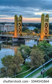 SACRAMENTO, CALIFORNIA/U.S.A. - OCTOBER 30, 2016: An HDR image blended together from multiple separate pictures showing Tower Bridge and West Sacramento greenway at dusk along the Sacramento River.