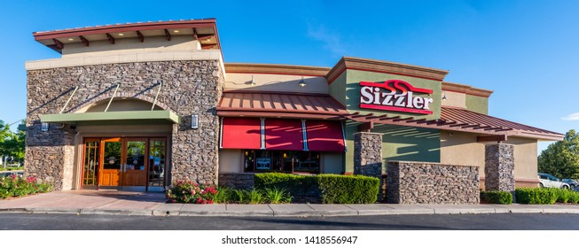 Sacramento, CA/USA 06/06/2019 Panoramic image of Sizzler's american steak house and salad buffet front building sign and logo
