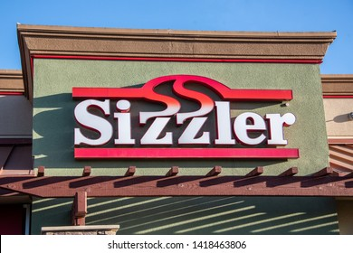 Sacramento, CA/USA 06/06/2019 Sizzler's american steak house and salad buffet front building sign and logo