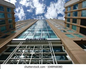 SACRAMENTO, CA/U.S.A. - APRIL 15, 2013: The Deloitte Consulting building in downtown Sacramento is a modern structure designed with lots of glass to reflect the sky and clouds.