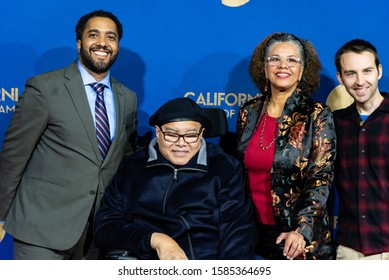 SACRAMENTO, CA/U.S.A. - DECEMBER 10, 2019: Dr. Maya Angelou's son Guy Johnson poses with family members as part of the red carpet event for the Hall of Fame inductees at the California Museum.