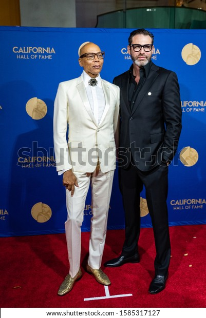 SACRAMENTO, CA/U.S.A. - DECEMBER 10, 2019: Television personality RuPaul Andre Charles stands with his husband Georges Lebar as part of the Hall of Fame inductees event at the California Museum.