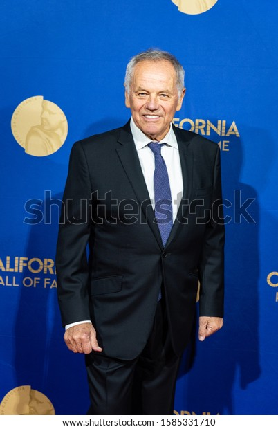 SACRAMENTO, CA/U.S.A. - DECEMBER 10, 2019: Austrian-American chef, restaurateur, and actor Wolfgang Puck poses during the red carpet part of the Hall of Fame inductees event at the California Museum.