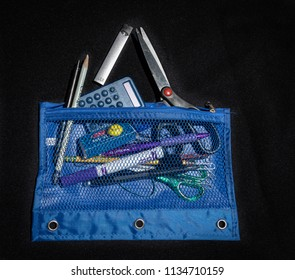 SACRAMENTO, CA/U.S.A. - JULY 12, 2018: A pencil case with various pens, pencils, calculator, scissors and an e-cigarette. E-cigarettes are becoming a challenge for school officials to find.