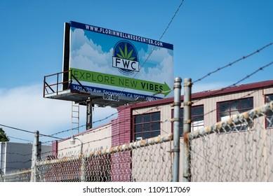 SACRAMENTO, CA/U.S.A. - JUNE 6, 2018: A billboard sign advertising the Florin Wellness Center, a marijuana dispensary located in South Sacramento.