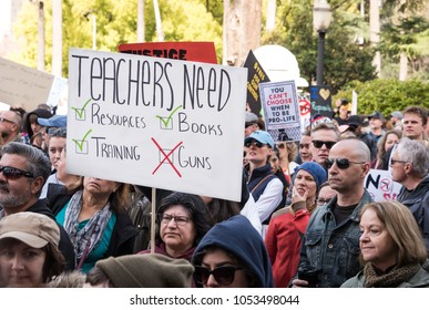 SACRAMENTO, CA/U.S.A.: MARCH 24, 2018: An unidentified woman holds her protest sign for teachers at the March for Our Lives rally, one of the many sister marches held in California's capital city.