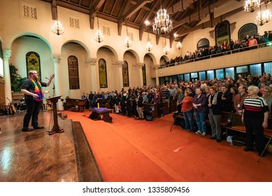 SACRAMENTO, CA/U.S.A. - MARCH 5, 2019: Rev. Matt Pearson leads attendees singing at First United Methodist Church at an event discussing the anti-gay Traditional Plan at which Bishop Carcano spoke.