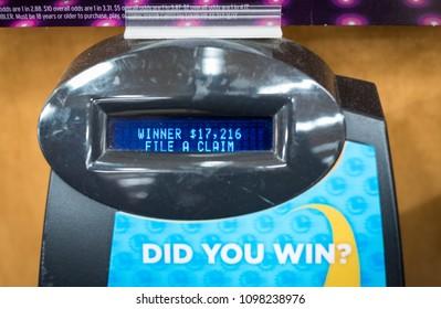 SACRAMENTO, CA/U.S.A. - MARCH 6, 2018: A photo of a California SuperLotto Plus machine screen showing a winning claim of over $17,000.00.