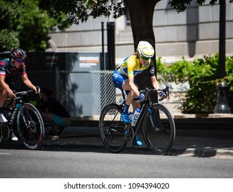 SACRAMENTO, CA/U.S.A. - MAY 19, 2018: Katie Hall, wearing her yellow jersey from stage 2, speeds along during the final stage of the Amgen Tour of California bike race in downtown Sacramento.