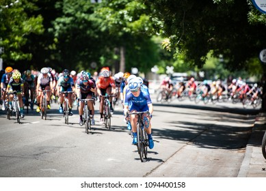 SACRAMENTO, CA/U.S.A. - MAY 19, 2018: A United Healthcare rider takes the lead of the women's peloton during the final stage of the Amgen Tour of California cycling race.