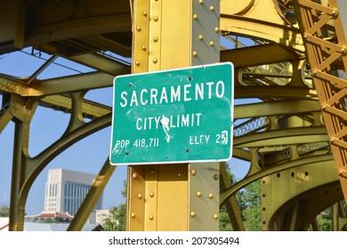 Sacramento City Limit Sign on the Tower Bridge over the Sacramento River in Sacramento, California.