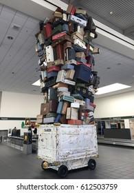 SACRAMENTO, USA - MAR 30, 2017: SMF international airport Baggage Claim Decoration of Piled Up suitcases.