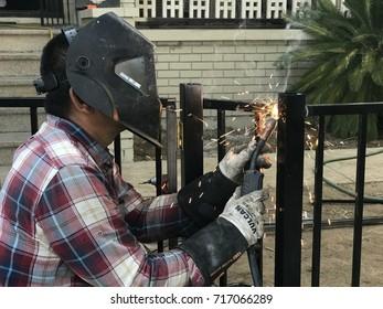 SACRAMENTO, USA - SEP 17, 2017: welder Man, welding, blacksmith welding a gate