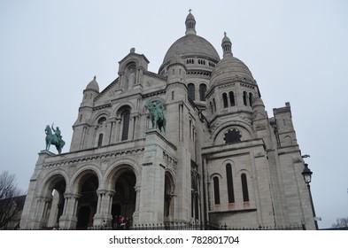 SACRE COER, MONTMARTRE, PARIS/FRANCE - DECEMBER 2017: Front view of Sacre Coer church in Montmartre, rainy and cloud day in Paris/France.