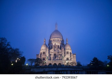 Sacre Coeur Basilica in Montmartre, Paris, illuminated during a winter night. The Basilica of the Sacred Heart of Paris is a Roman Catholic church and minor basilica