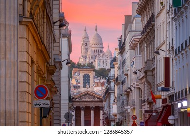Sacre Coeur Basilica on top of the Montmartre hill at sunset. Paris. France.