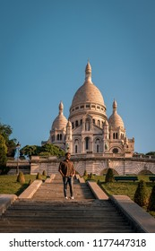Sacre Coeur Cathedral in Montmartre, Paris, France, young man on an early morning in Paris