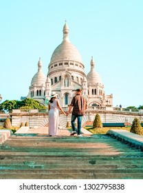 Sacre Coeur Cathedral in Montmartre, Paris, France, hill of Montmartre Paris with church ,couple walking at the hill