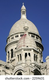 Sacre Couer Basilica on Montmartre hill in the north of Paris in France showing the central dome against a deep blue sky