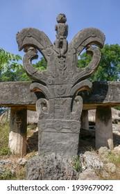 Sacred ancient Watu Kajiwa carved headstone and megalithic tomb in traditional Prai Goli village, West Sumba island, East Nusa Tenggara, Indonesia