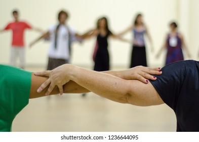 SACRED CIRCULAR DANCE, PEOPLE UNITED ON A WHEEL