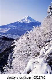 The Sacred Fuji in winter as a view from mountain peak