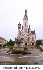 Sacred Heart Church in Kőszeg, Jézus Szíve-plébániatemplom, Plague Column. Hungary.