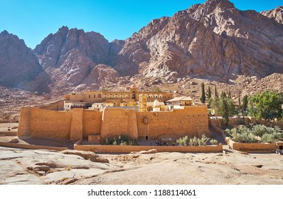 The Sacred Monastery of God-Trodden Mount Sinai (St Catherine Monastery) is surrounded by red rocks of Sinai desert, Egypt.