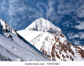 Sacred mount Kailash (elevation 6638 m) on blue sky background in Tibet, China. It is considered a sacred place in four religions: Bon, Buddhism, Hinduism and Jainism.