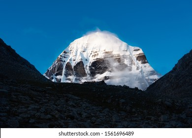 Sacred mountain in Tibet - Mount Kailash with blue sky