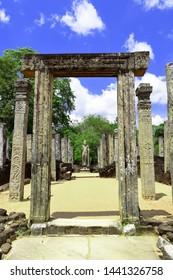 Sacred Quadrangle with standing statue of Lord buddha and stone pillars, Ancient ruins Sri Lanka, Unesco ancient city Polonnaruwa