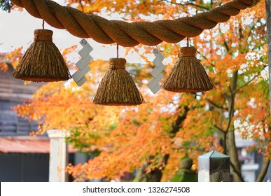 Sacred rope at the Japanese Shrine in the Autumn Season of Japan.