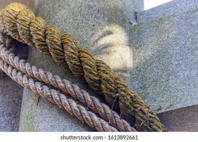 Sacred rope, or shimenawa, on torii gate to small local shinto shrine, Kanazawa, Japan.
