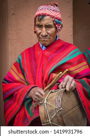 Sacred Valley, Cusco, Peru - Oct 13, 2018: An indigenous Quechua man in traditional dress and drum