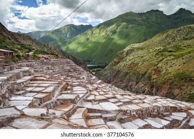 Sacred Valley, Peru â?? March 24, 2015: Scenes of daily life at Maras salt pans in Peruâ??s Sacred Valley, where local people have farmed salt for more than 500 years. General travel imagery for Peru.