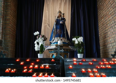 Sacrificial candles in front of a Marian altar in the Roman Catholic St. John the Baptist church, Sluis, Zeeland, Netherlands, 08 07 2019