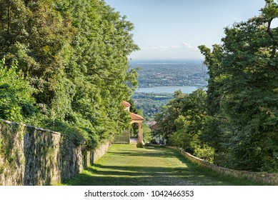 Sacro Monte of Varese (Santa Maria del Monte), Italy. Sacred way that leads to medieval village, with the ninth chapel. In the background Lake Varese. World Heritage Site - Unesco