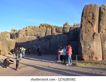 SACSAYHUAMAN / PERU, August 16, 2018: Tourists take photos at the ruins of Sacsayhuaman